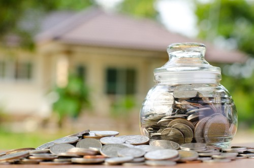 Money,Coins,With,Home,,Saving,For,Buy,Home,Concept